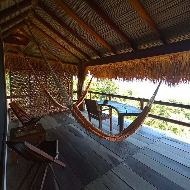 Orion Suite's terrace with hammocks is the perfect oasis for relaxing