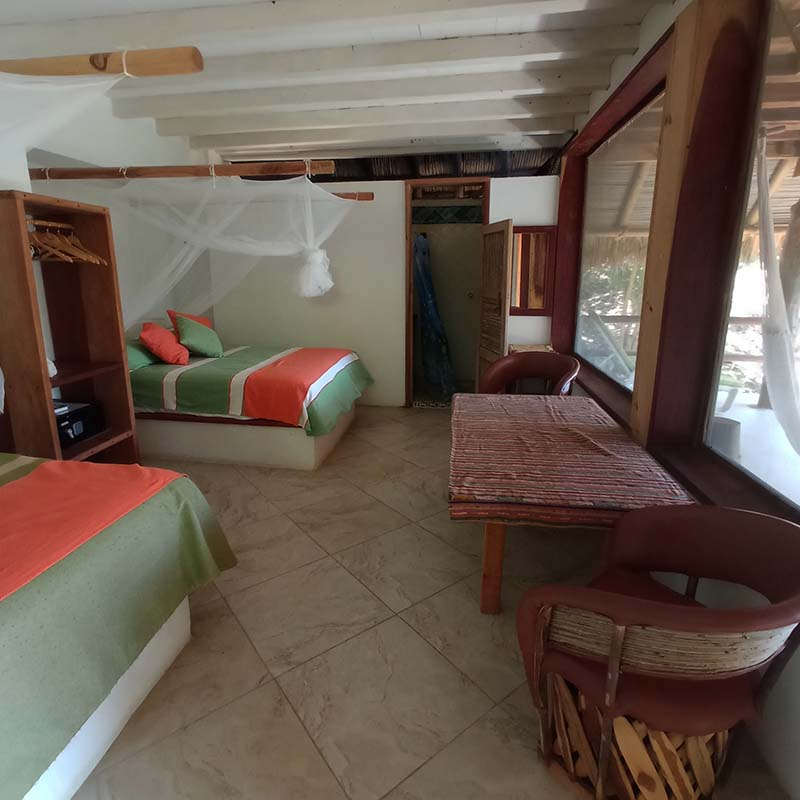 Bungalow Garrobo also has a table with chairs and a separate bathroom