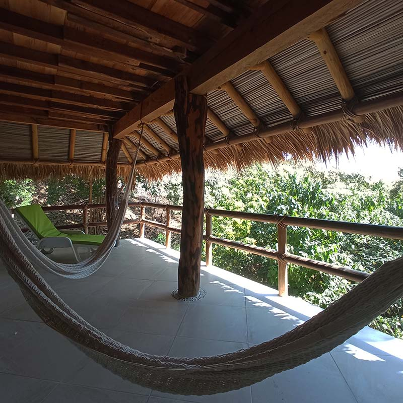 Garrobo's terrace with hammocks