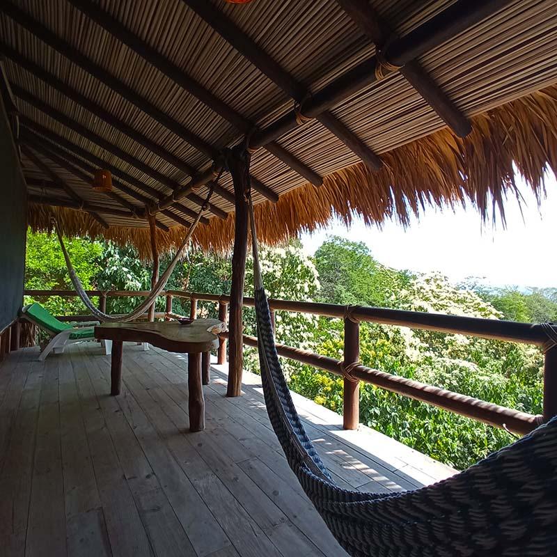 Iguana's terrace with hammocks and a beautiful sea view